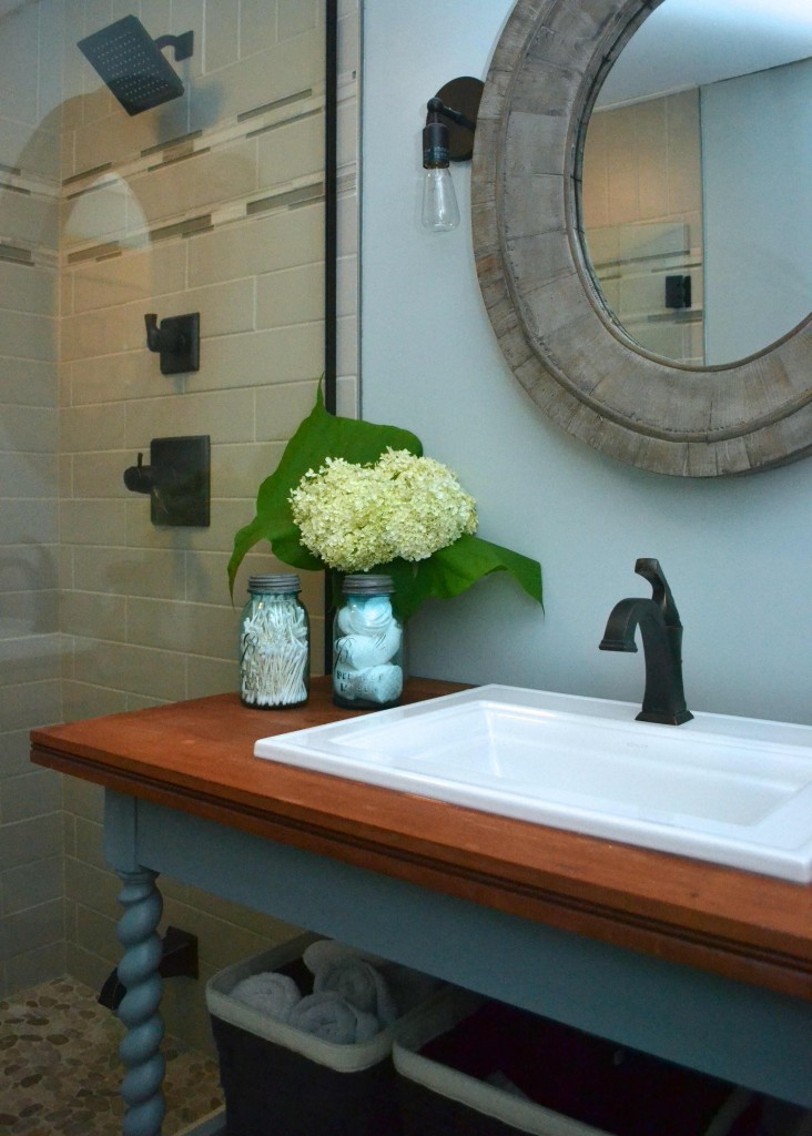 Modern cottage bath with subway tile and repurposed library table as vanity