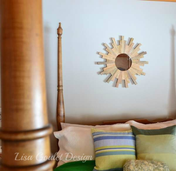 Blue and green cottage bedroom with sunburst mirror