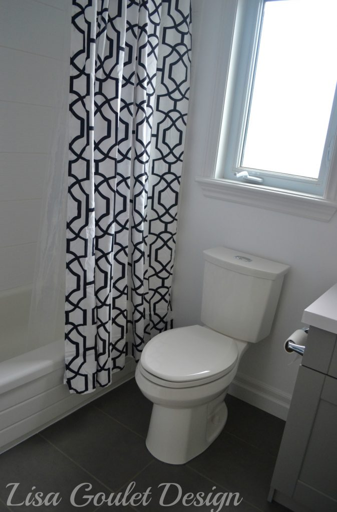 graphic shower curtain, toilet, flooring