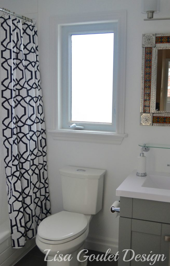 shower curtain, vanity and toilet view