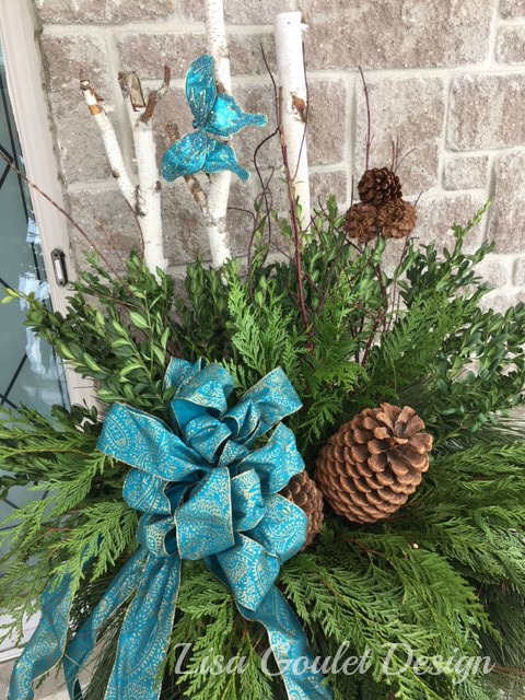 Exterior christmas urn with turquoise accents.
