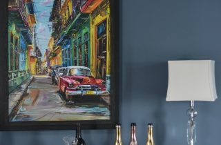 CUBAN ARTWORK IN NAVY DINING ROOM