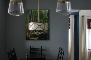 Blue dining area, vintage brass lighting