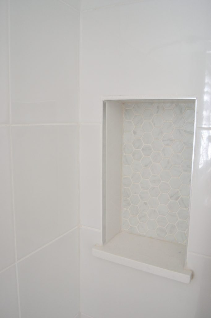 Inset shower shelf