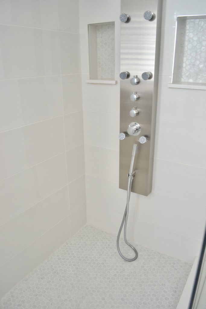 Custom shower with two inset shelves