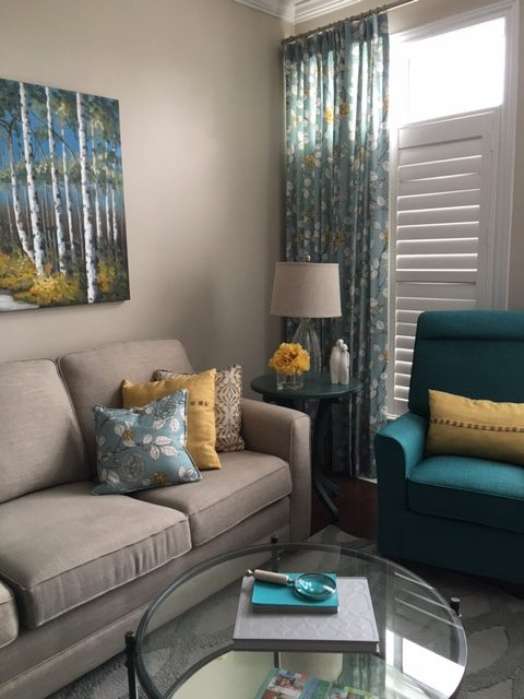 Colourful turquoise and yellow living room