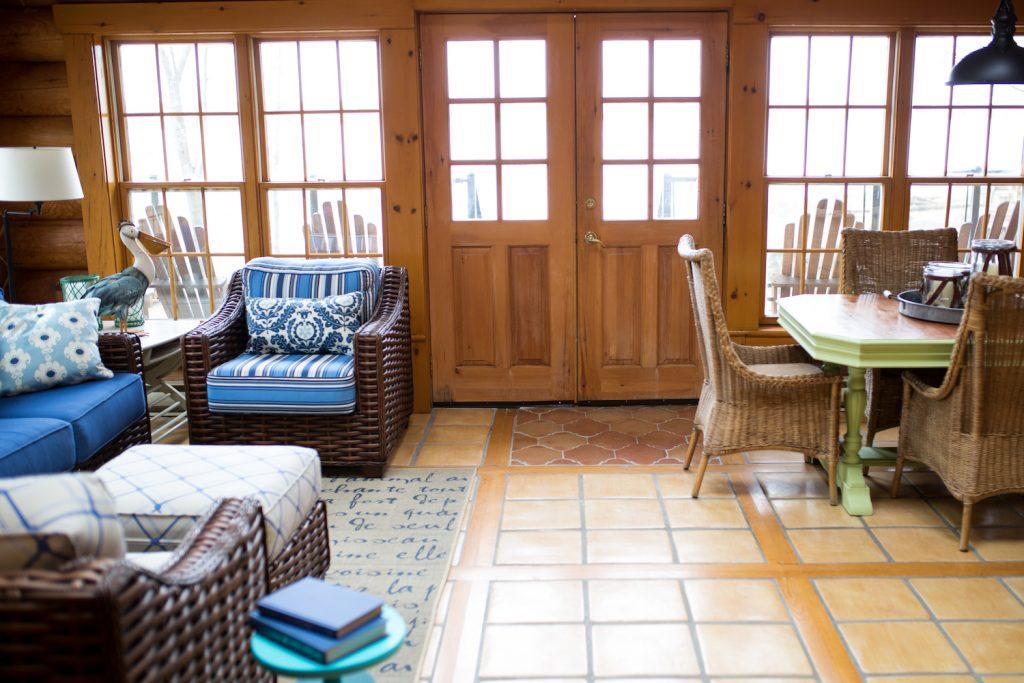 Blue and white log home sunroom