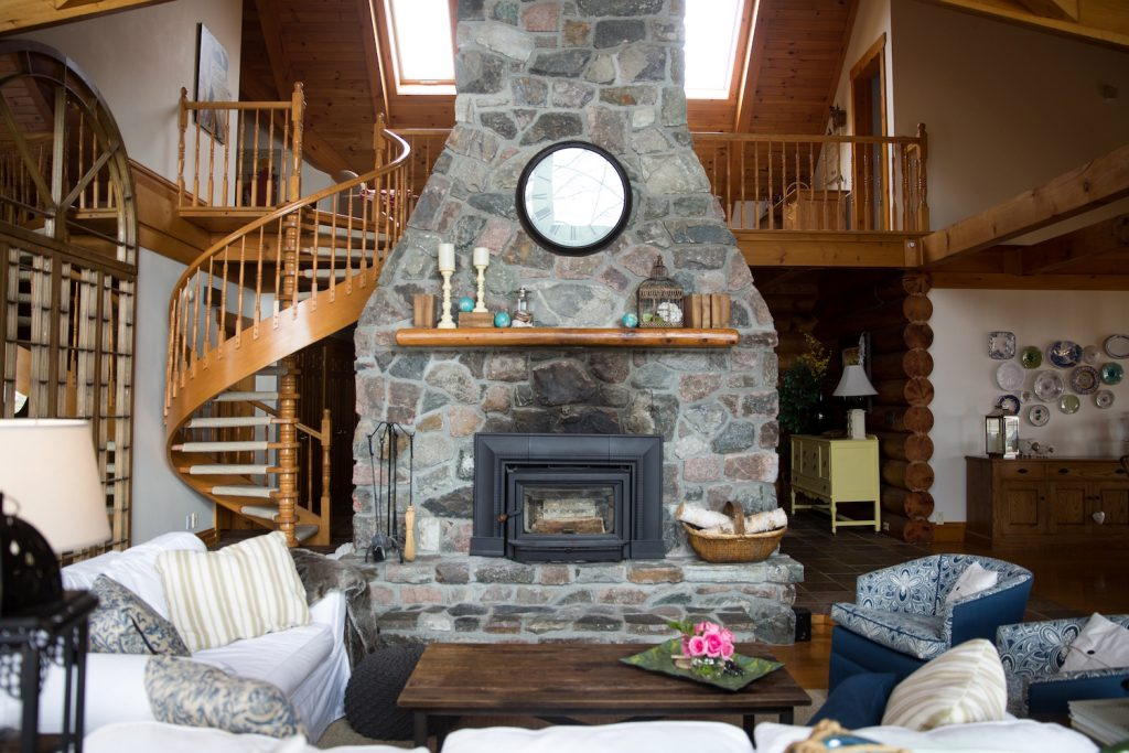 Cottage living room with stone fireplace