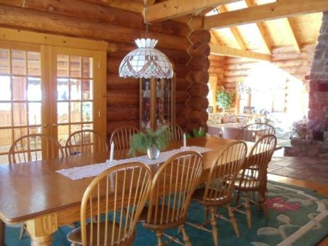 Log home dining room before