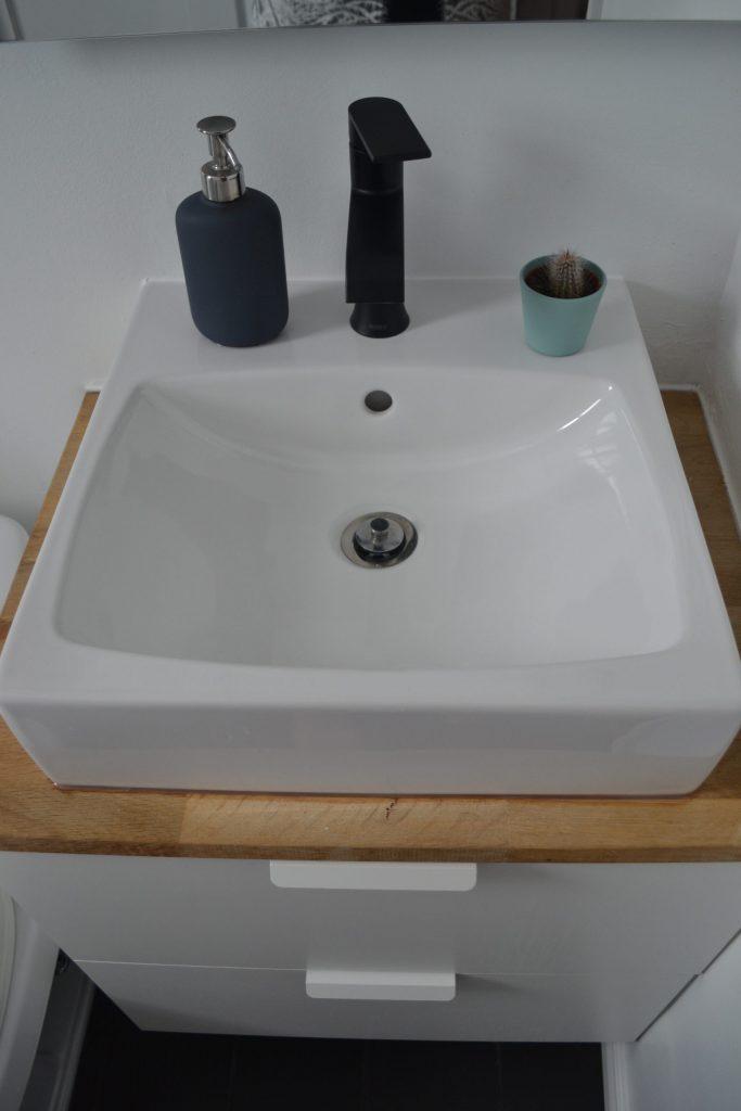 Black faucet on Ikea sink and vanity