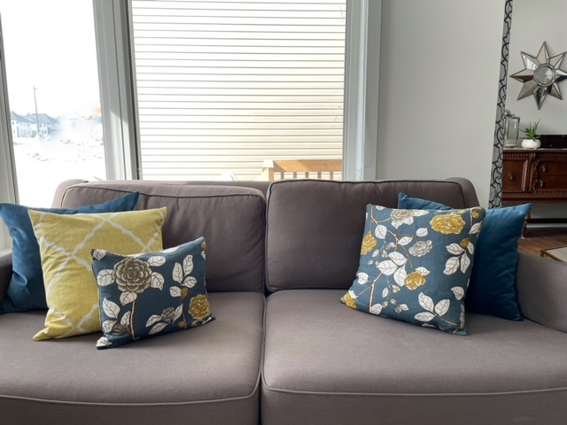 Three coordinating fabrics for throw pillows.