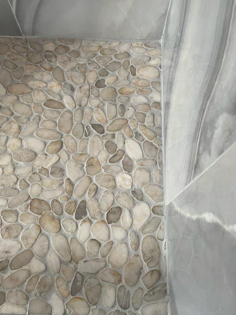 Flat river rock mosaic shower floor